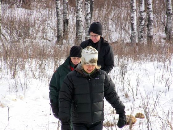 Investigating elk killed by wolves as part of a snowshoe learning adventure